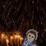 Razel puppet in front of shower of gold fireworks