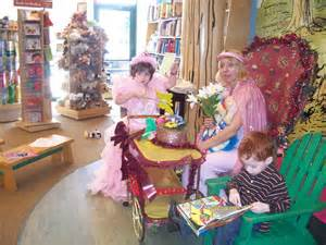Princess holds butterfly wand as Suzae holds flowers and UniCandle unicorn and brother reads on.